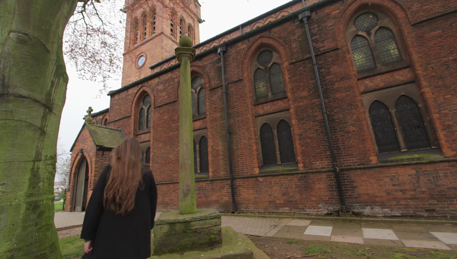 A video still of the preaching cross outside of All Saints Church