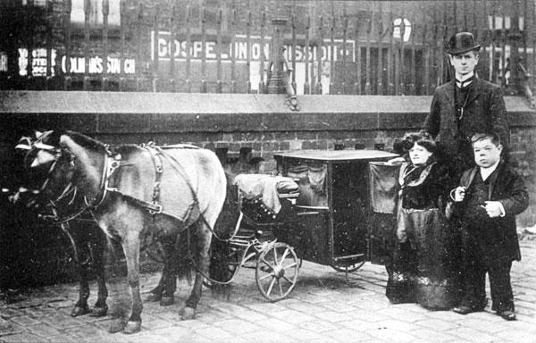 B+W image of male and female Dwarves at Bloxwich Wakes c1908 with small horse and carriage and full sized man